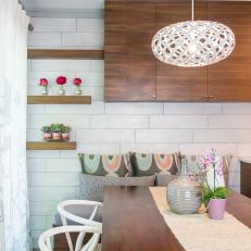 Midcentury Modern Dining Nook With White Tile Walls