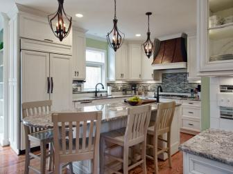 Traditional Kitchen With Eat-In Island and Wrought Iron Pendant Lighting