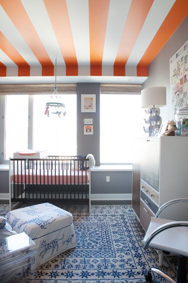 Gray Modern Nursery With Orange Striped Ceiling