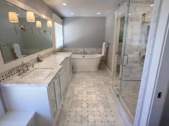 Soft Gray Bathroom With Marble Flooring and Countertop