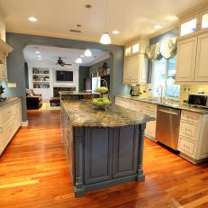 Spacious Transitional Galley Kitchen With Warm Mahogany Flooring