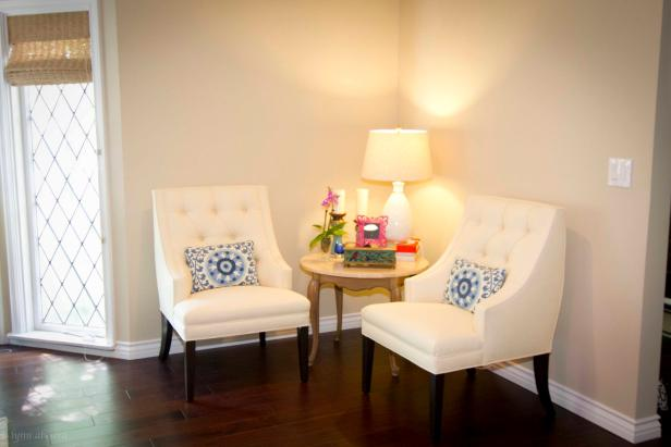 Neutral Seating Nook With White Armchairs