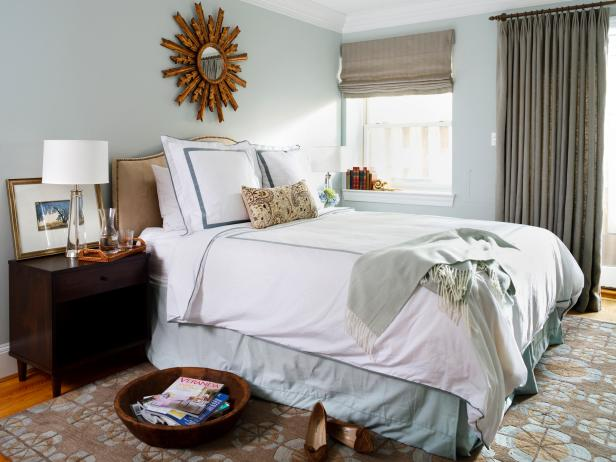Blue Transitional Bedroom With Patterned Area Rug and Brown Accents