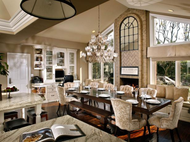 Neutral Open Dining Room With Chandelier and Window Seat