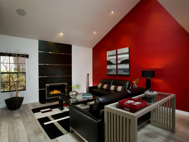 Living Space With Bold Red Focal Wall and Modern Black Furnishings