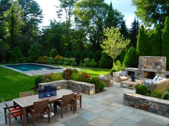 Backyard With Gray Paver Patio and Pool