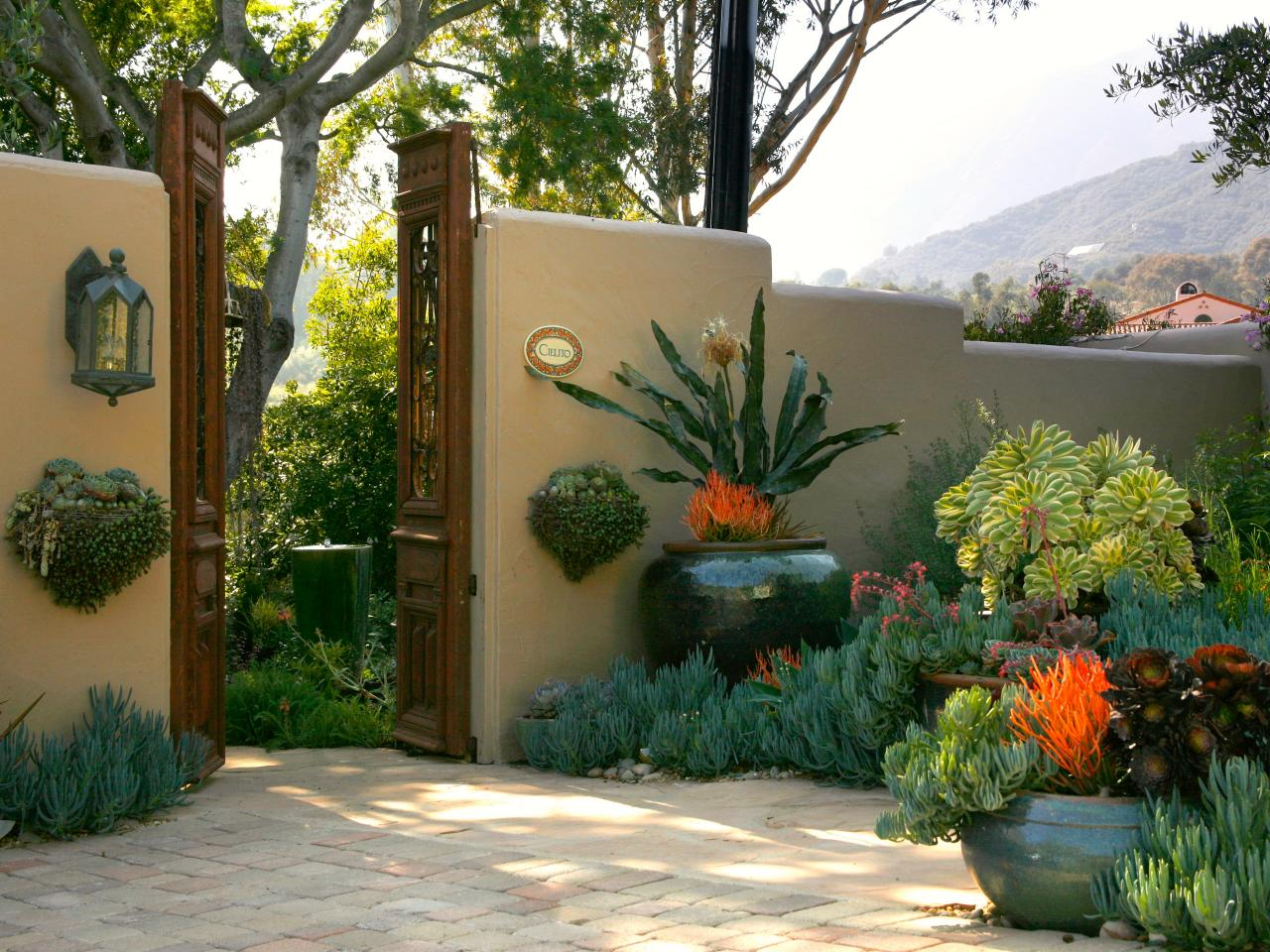 20 outdoor structures that bring the indoors out outdoor for Courtyard landscaping pictures