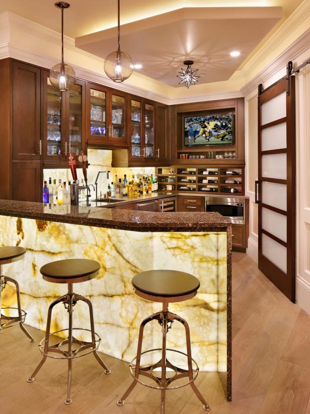 Bar With Traditional Wood Cabinets and Built-In TV