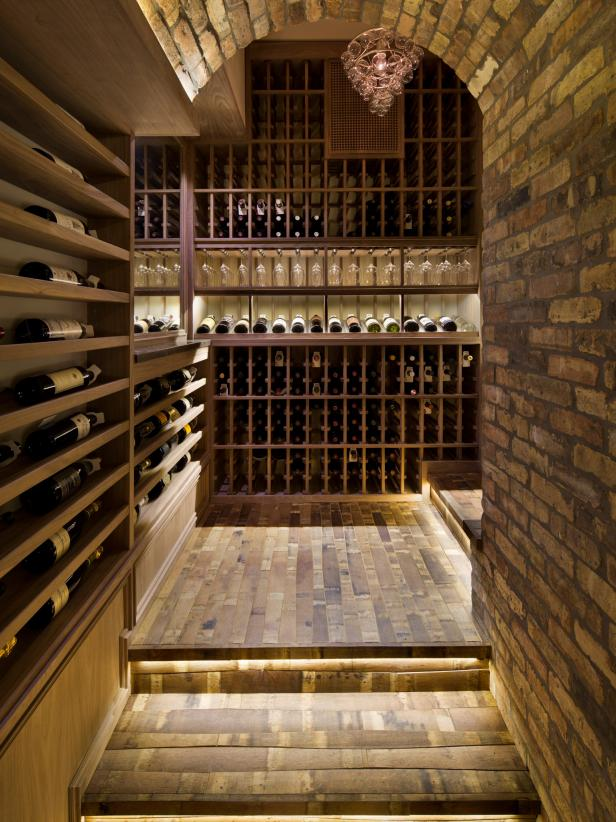 Shelf and stair lights illuminate the wine cellar.