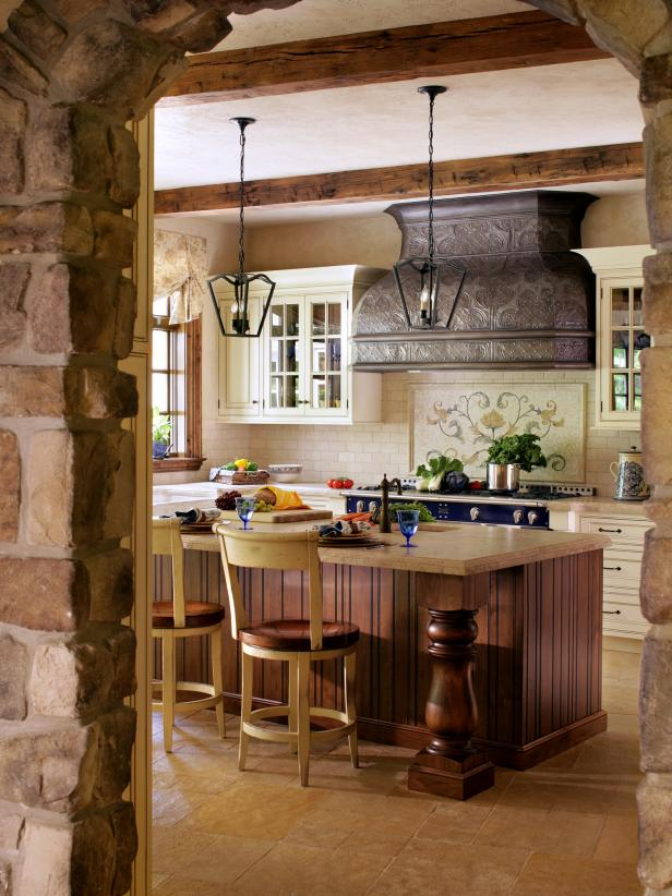 French Country Kitchen with Stone Entrance and Tin Range Hood
