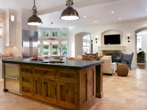 Rustic Kitchen Island With Dark Countertop and Refrigerator Drawers