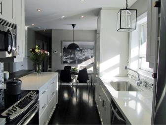 Black and White Galley Kitchen With Glass Lantern Pendant