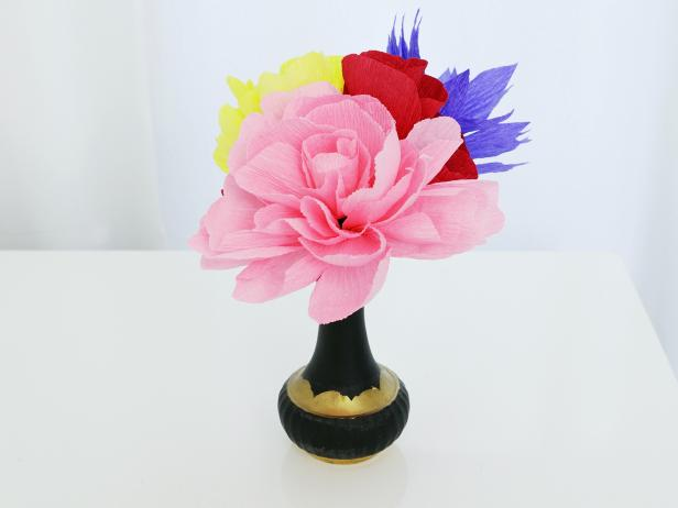 Display the paper flowers in vases together or separately.