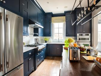 Navy and White Transitional Kitchen With Stainless Steel Refrigerator