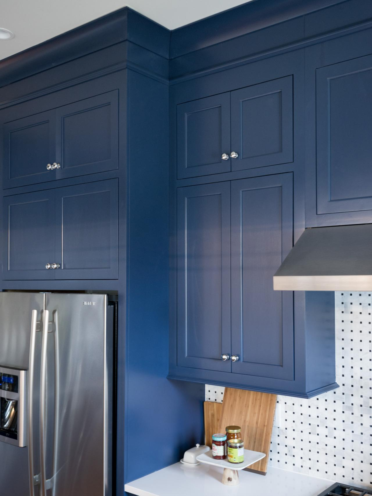 Photos hgtv for Dark blue kitchen cabinets