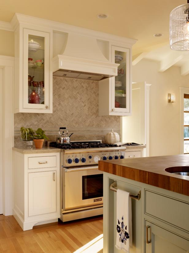 Yellow Kitchen With Sage Green Island and White Cabinetry