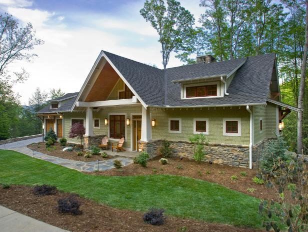 Craftsman-Style Home With Green Siding and Stone Pathway
