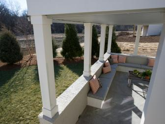 Covered Porch With White Columns and Bench Seating