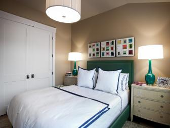 Neutral Guest Bedroom With Green Upholstered Headboard