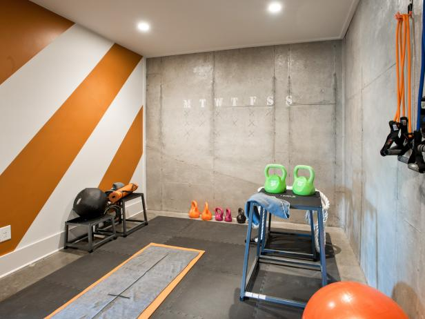 Basement Rec Room With Orange and White Stripe Wall