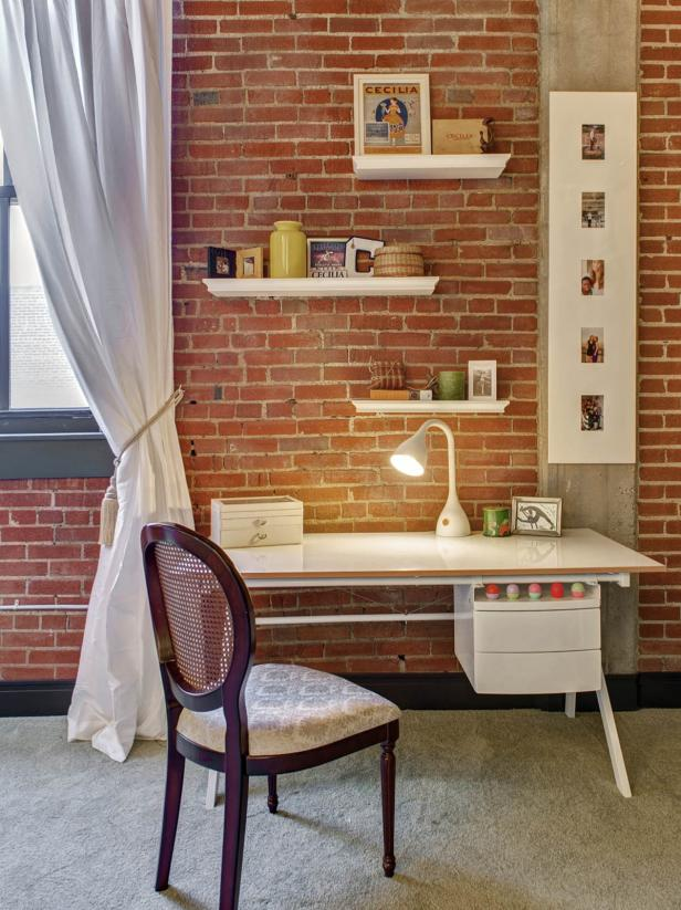 Home Office with Modern White Desk Against Brick Wall