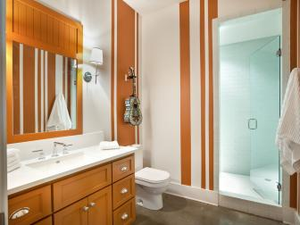 Contemporary Orange and White Striped Bathroom