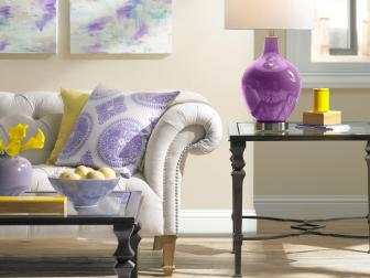 Transitional Neutral and Purple Living Room With Graphic Rug