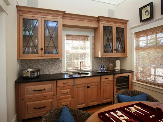 Game Room Beverage Center With Wood Cabinets and Tile Backsplash