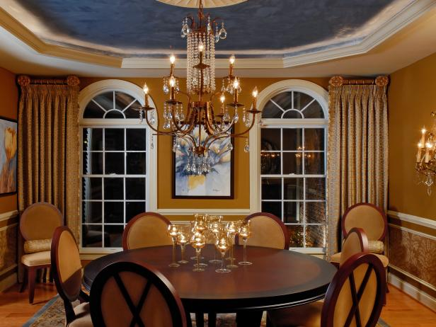 Elegant Dining Room With Tray Ceiling and Chandelier