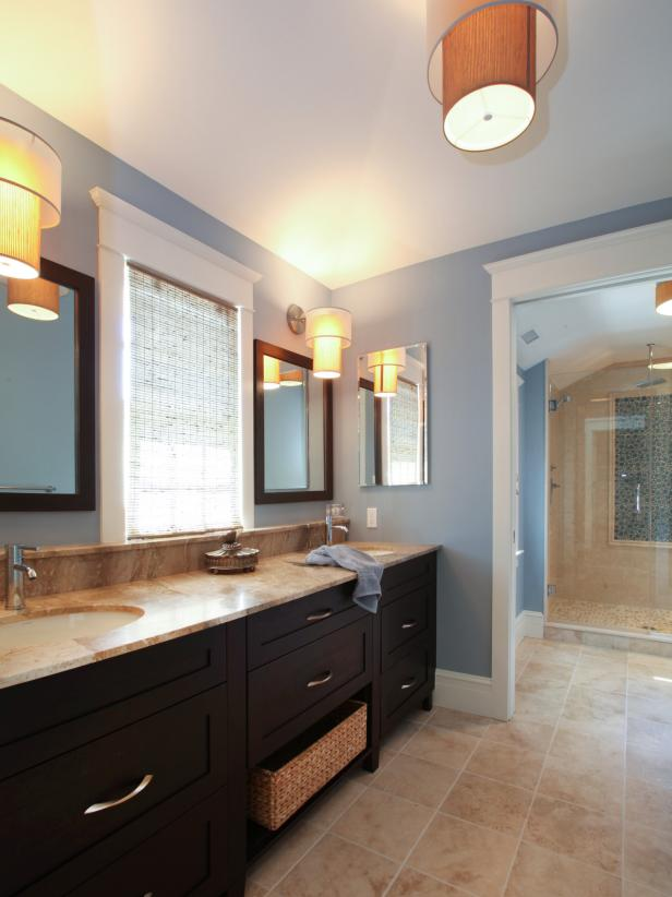 Light Blue Bathroom With Drum Shade Lights and Walk-In Shower