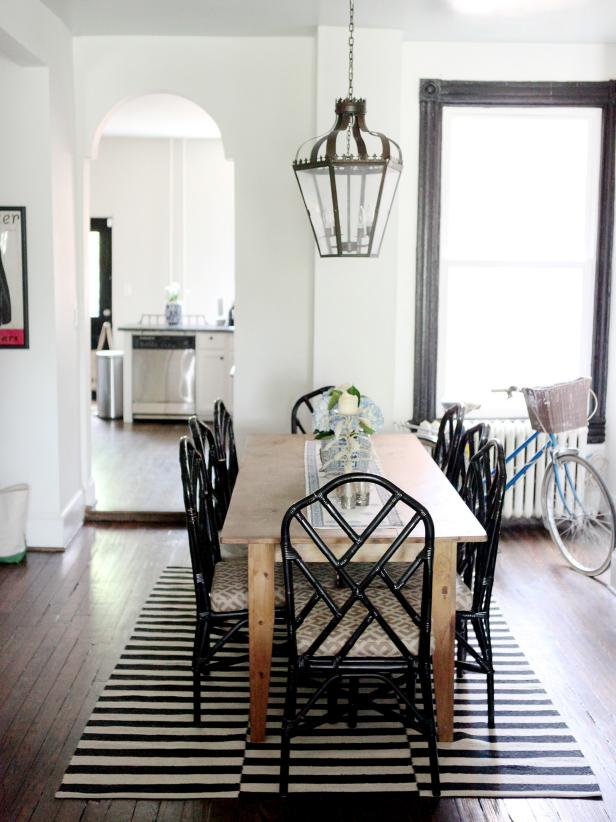 Eclectic Dining Space With Black Chairs and Farm Table
