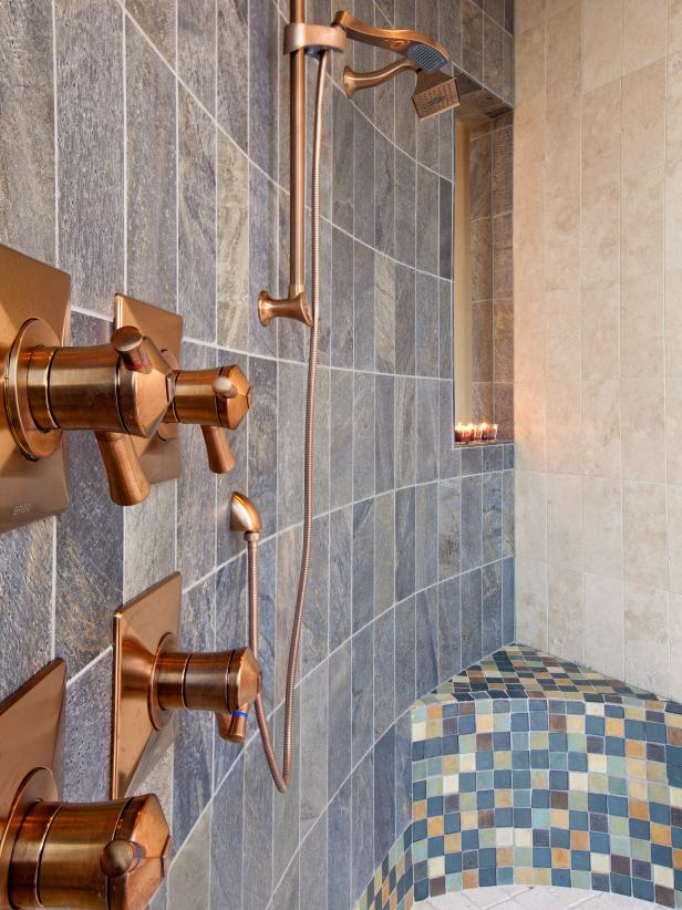 Walk-In Shower With Colorful Tile and Bronze Fixtures