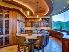 Neutral Southwest-Style Kitchen With Curved Island