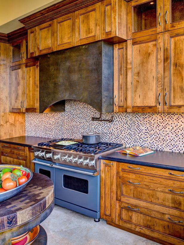 Distressed Wood Cabinets, Blue Range and Tile Backsplash