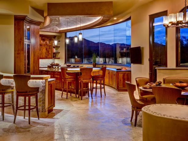 Open Plan Kitchen With Rustic Cabinets and a View of the Mountains