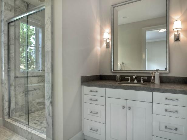 White and Gray Master Bathroom With Marble Tile
