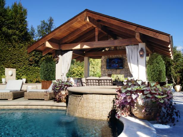 Rustic Cabana with Outdoor Curtains Overlooking Swimming Pool