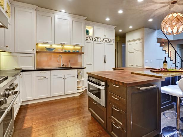 Kitchen With White Cabinets and Contrasting Brown Island