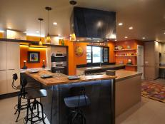 Orange Contemporary Kitchen With Large Metal and Wood Island