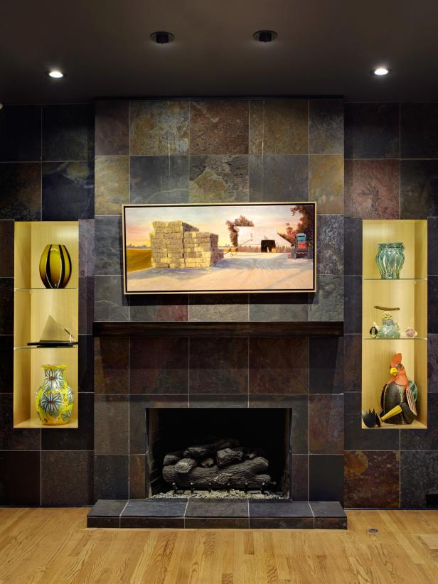 Yellow Recessed Shelves Flanking Contemporary Slate-Tile Fireplace