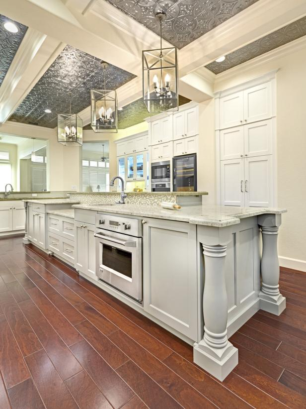 White Kitchen With Large Island and Tin Ceiling