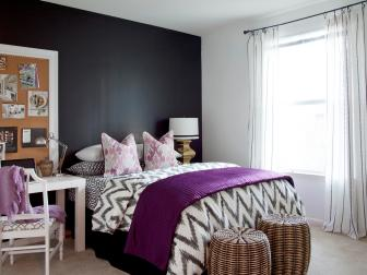 A Purple Bedspread and Quirky Corkboard Brighten Up a Darkly Painted Room