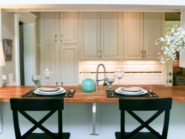 White Transitional Kitchen With Black Bar Stools