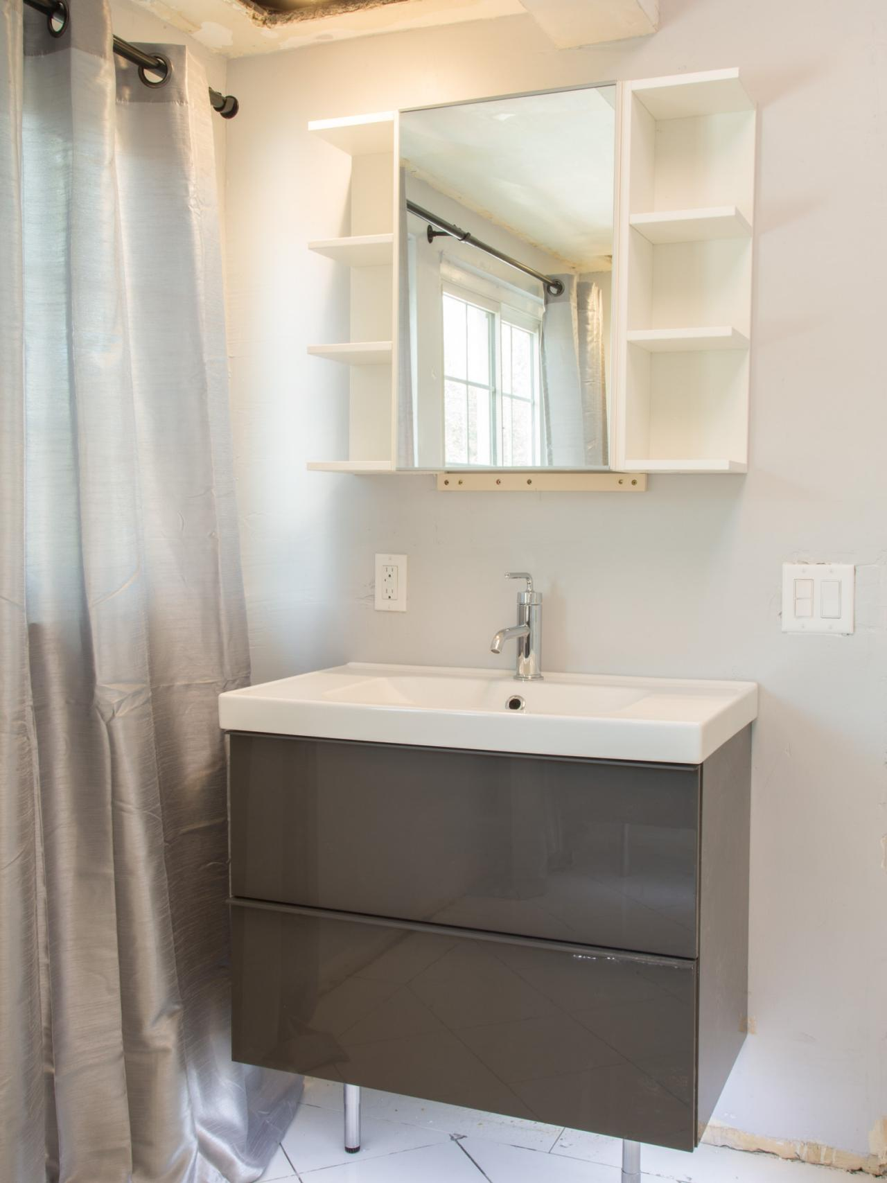 sleek gray vanity in contemporary bathroom in this bathroom makeover