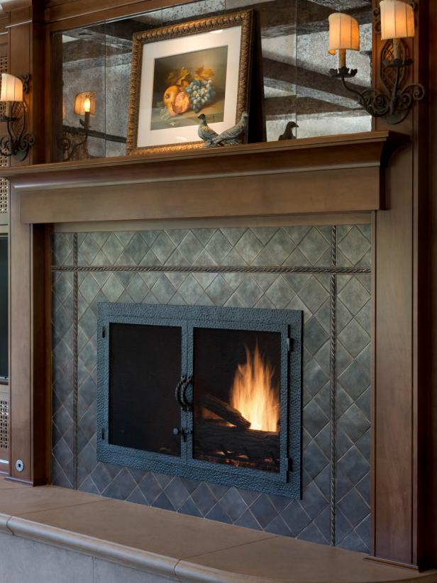 Wood Mantel in Rustic Family Room With Sconce Lighting