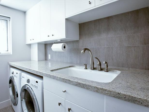 Modern Laundry Room with Utility Sink and White Cabinets