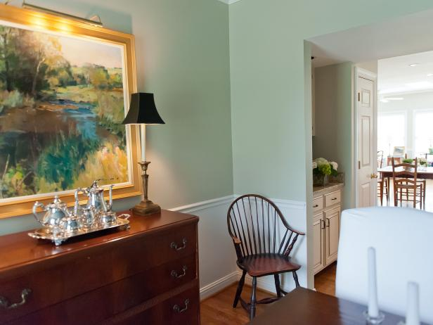 Traditional Dining Room With Wood Dresser and White Chair Molding