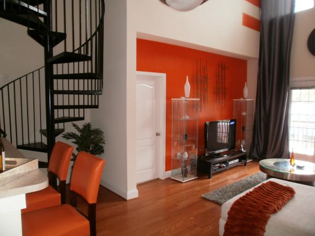 Orange and White Family Room With Spiral Staircase