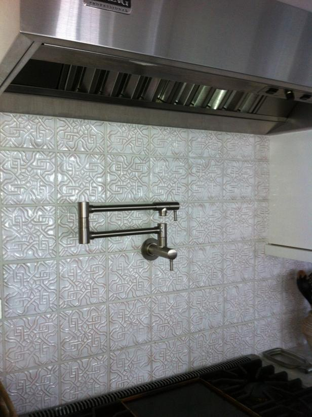 White Tile Backsplash With Embossed Geometric Pattern