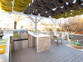 Outdoor Kitchen With Gray and Yellow Pergola